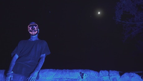 Scary masked man in moonlight