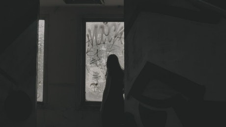 Scary woman seeing through the window