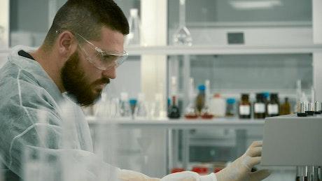 Scientist adjusting equipment in a laboratory
