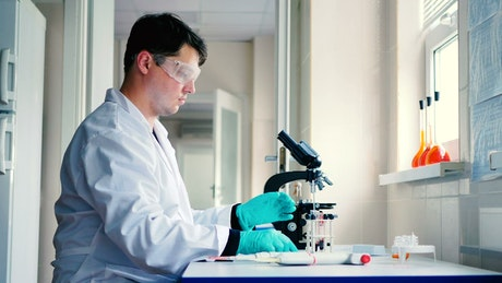 Scientist in a laboratory preparing a sample