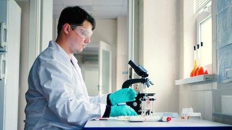 Scientist in a laboratory preparing a sample