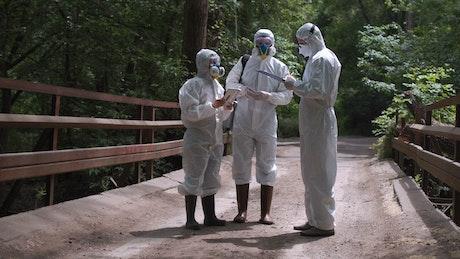 Scientist in biohazard suits on the bridge