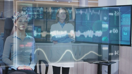 Scientist looks at DNA info on holographic screens