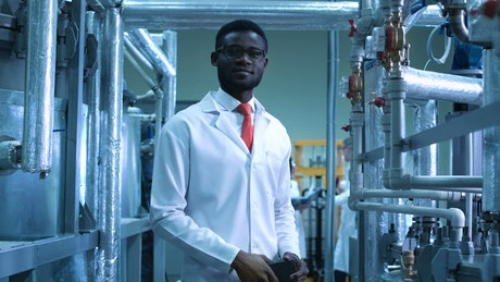Scientist man posing in the laboratory