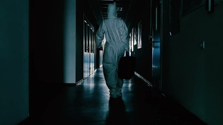 Scientist walking down a corridor