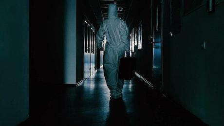 Scientist walking down a corridor
