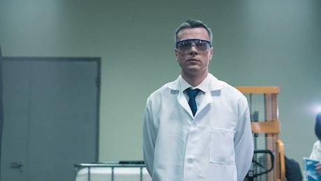 Scientist walking in the lab