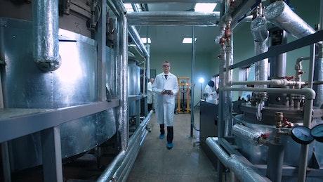 Scientist walking through laboratory