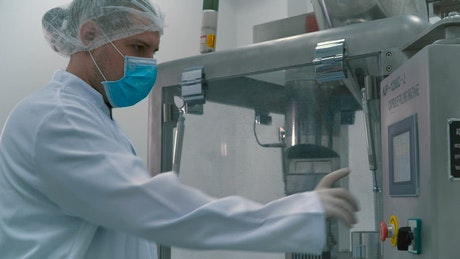 Scientist wearing masks and gloves in a laboratory