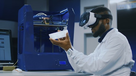 Scientist working with VR glasses and 3D printer