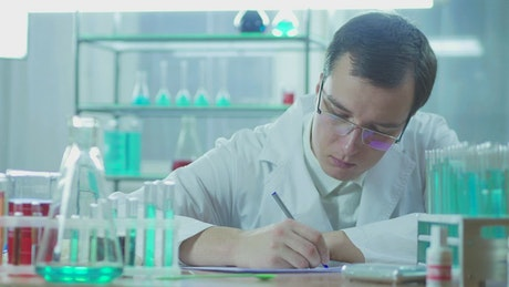 Scientist writing in the lab