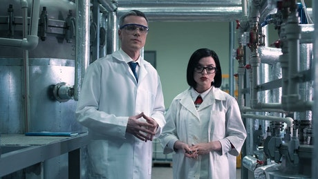Scientists talking in the laboratory