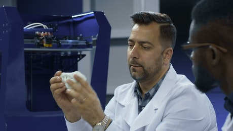 Scientists working with a 3-D printed skull
