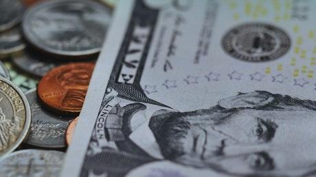 Scrambled American coins and bills seen very close