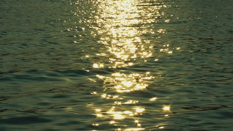 Sea water reflecting the light of the sunset