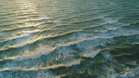 Sea water rippling and foaming gently