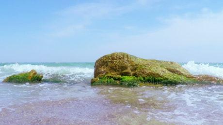 Sea waves breaking on the stones
