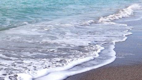 Sea waves in a sandy beach