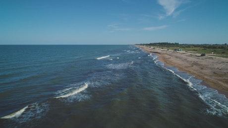 Sea waves reaching the beach in the seashore