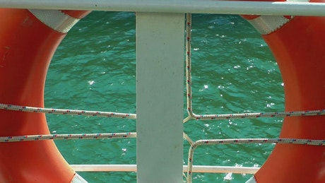 Seawater seen trough a lifeguard on a boat