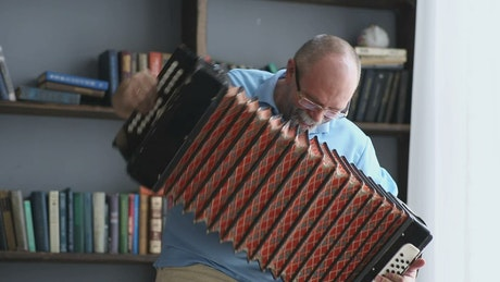 Senior man playing the accordion