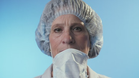 Serious doctor takes off mask, portrait