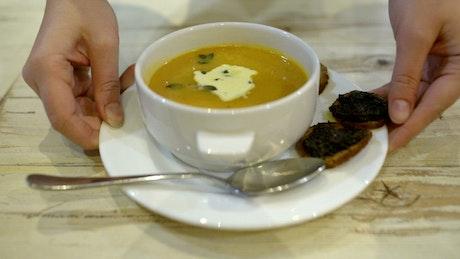Serving a bowl of soup