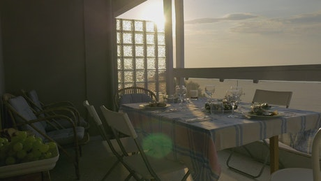 Serving a family dinner on the balcony
