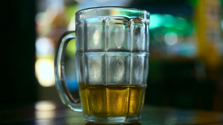 Serving cold beer in the glass