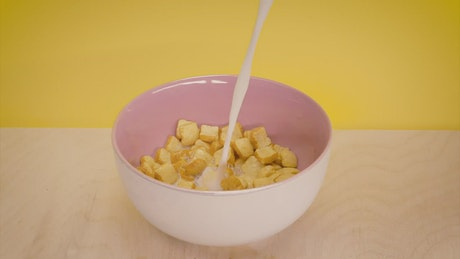 Serving milk in a bread-shaped cereal bowl