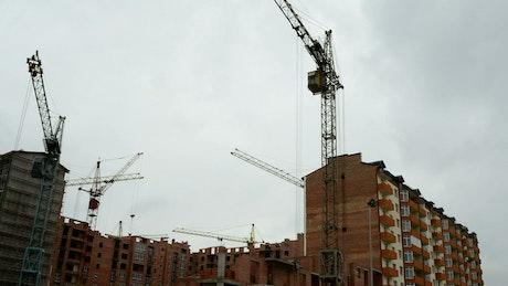 Several cranes at a construction site
