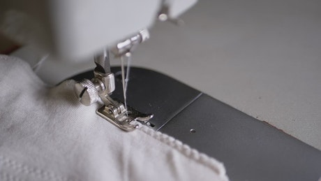 Sewing machine needle in slow motion