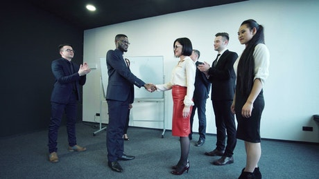 Shaking hands and smiling after negotiation