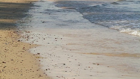 Shallow waves on a dirty beach