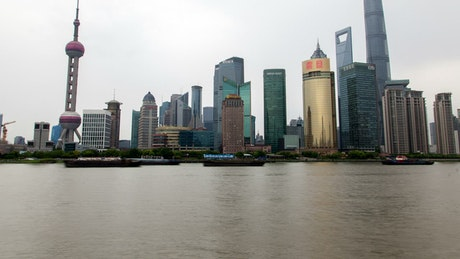 Shanghai city skyline and the river traffic