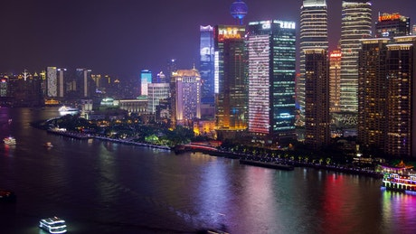 Shanghai river and city skyscrapers at night