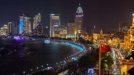 Shanghai river and city skyscrapers illuminated