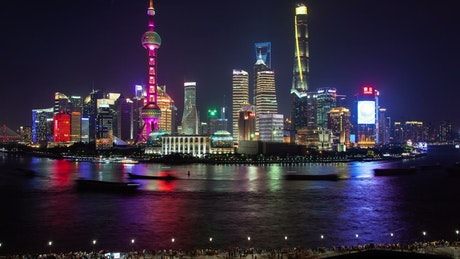Shanghai river and illuminated city buildings