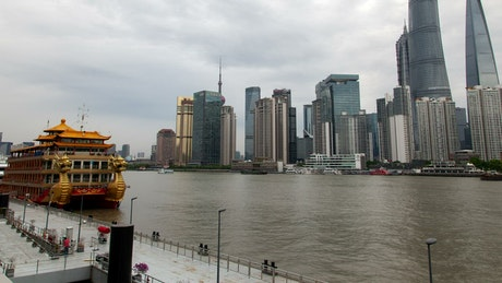 Shanghai river and the cityscape pan up