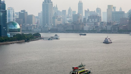 Shanghai river traffic and the city buildings