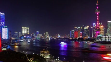 Shanghai river with illuminated city buildings