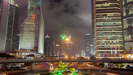 Shanghai roundabout and skyscrapers at night