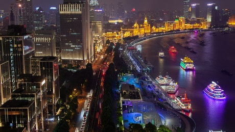 Shanghaiing city scape in the river at night