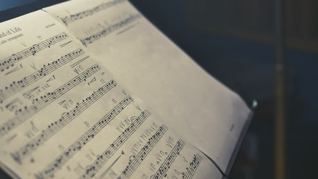 Sheet music played by a violinist in a studio