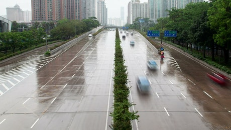 Shenzhen wet highway with traffic