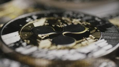 Shining Ripple Bitcoin coins slowly spinning