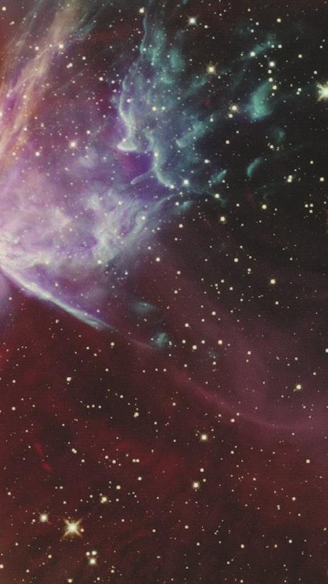 Shining stars around a blue nebula