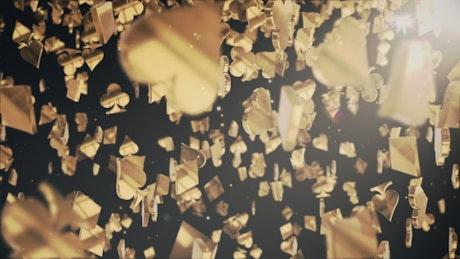 Shiny golden poker figures falling
