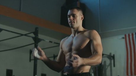 Shirtless man preparing for training