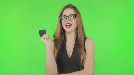 Shopping model poses with credit card on greenscreen